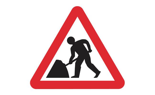 Men at work road sign UK
