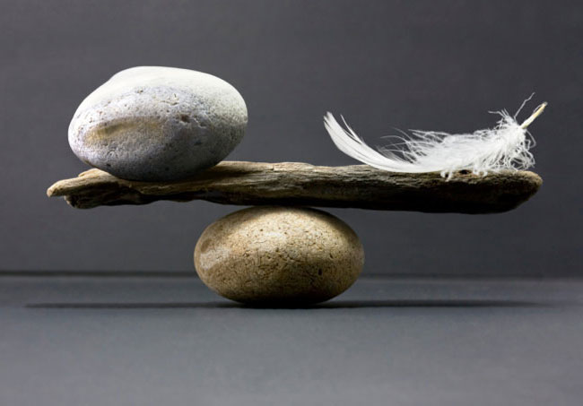 Balancing a rock and a feather