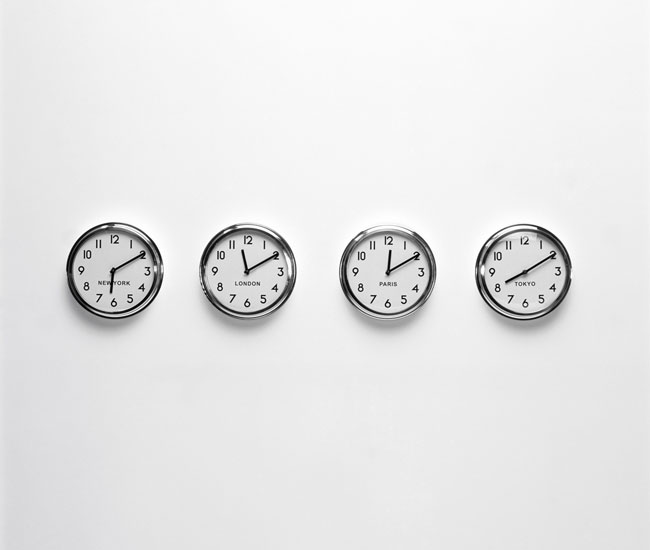 Wall clocks showing world times