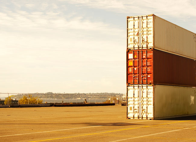 three shipping containers in a dock
