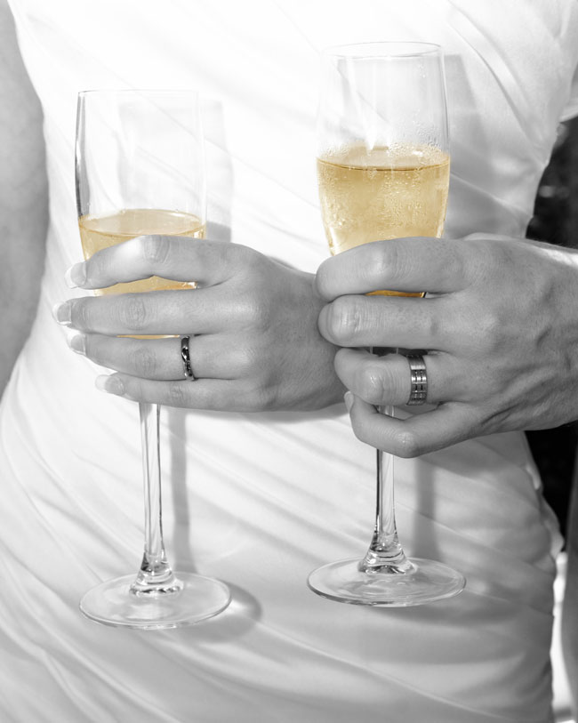 wedding rings champagne glasses